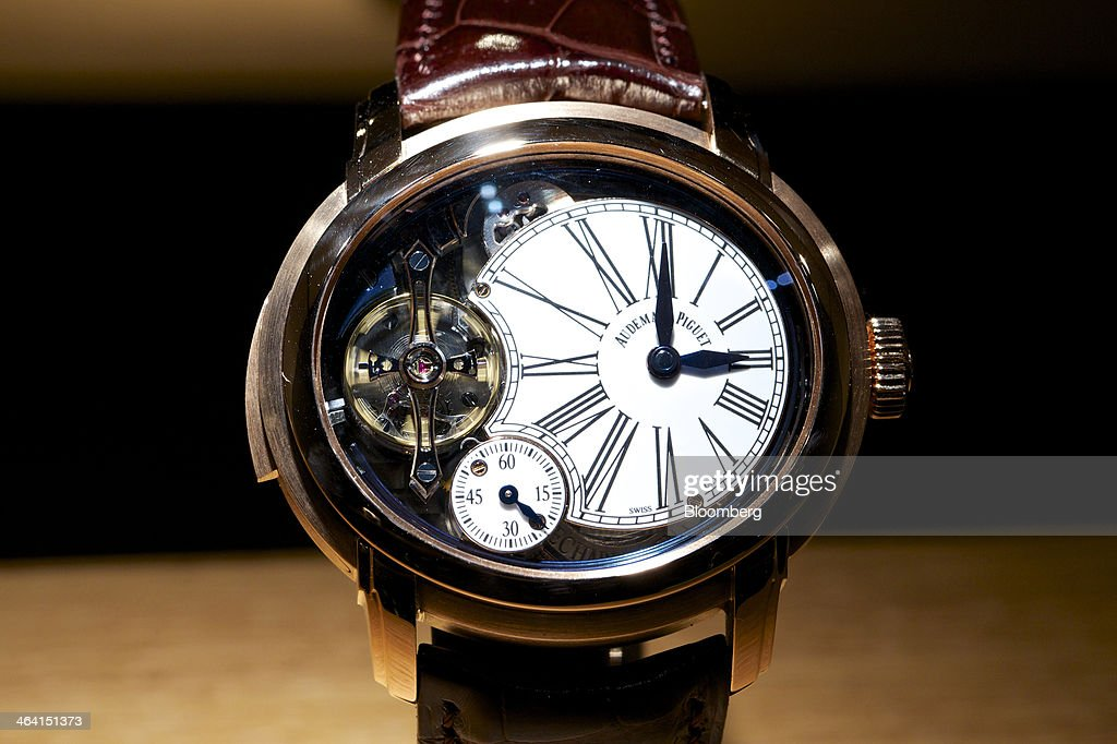 A Millenary Minute Repeater luxury wristwatch, manufactured by Audemars Piguet, sits on display at the Salon International de la Haute Horlogerie (SIHH) watch fair in Geneva, Switzerland, on Monday, Jan. 20, 2014. Enthusiasts coveting $50,000 Cartier watches at the Swiss industry's annual fair bumped opening meetings to resolve the three-year-old Syrian civil war out of the lakeside town. Photographer: Gianluca Colla/Bloomberg via Getty Images