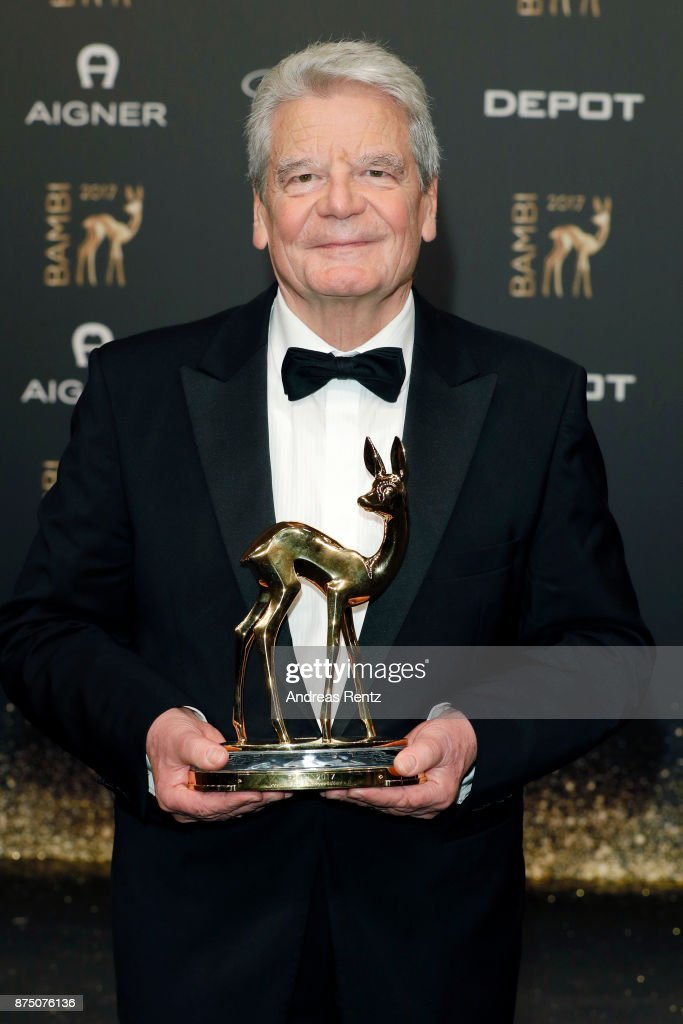 'Millenium' award winner Joachim Gauck poses with award at the Bambi Awards 2017 winners board at Stage Theater on November 16, 2017 in Berlin, Germany.
