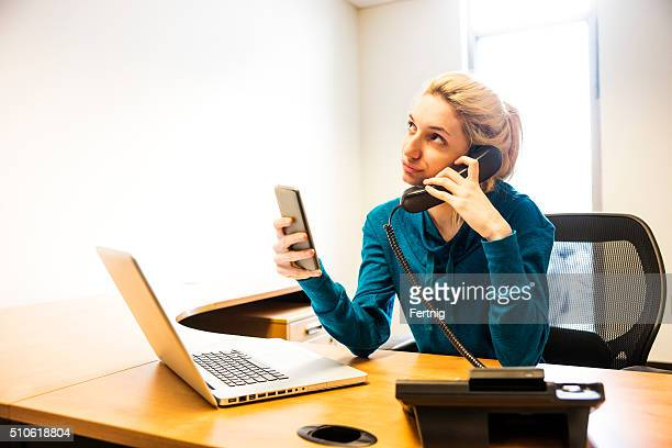 Millennial at work texting on a smartphone
