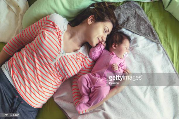 Millennial generation mother - young mother playing with her baby girl