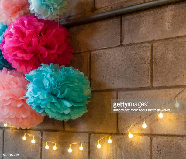 Millennial Pink - Wall decoration with light string and predominant pink elements.