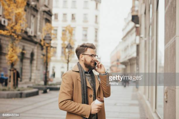 Millennial with bright smile making a phone call