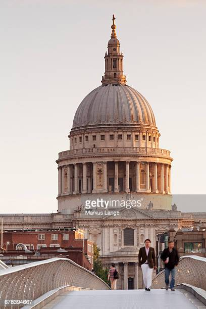 Millennium Bridge and St. Pauls Cathedral at sunrise, London, England, United Kingdom, Europe
