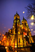 A Neo-Romanesque style, Catholic Church, called Millennium seen at the purple hour in Timisoara while raining, Timis County, Romania.