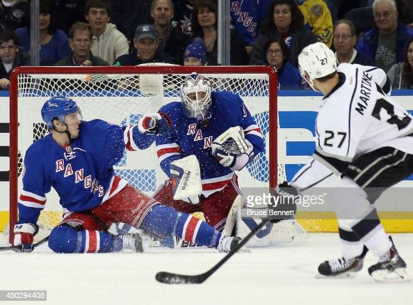 T Miller and goaltender Henrik Lundqvist of the New York Rangers block the net against Alec Martinez of the Los Angeles Kings at Madison Square...