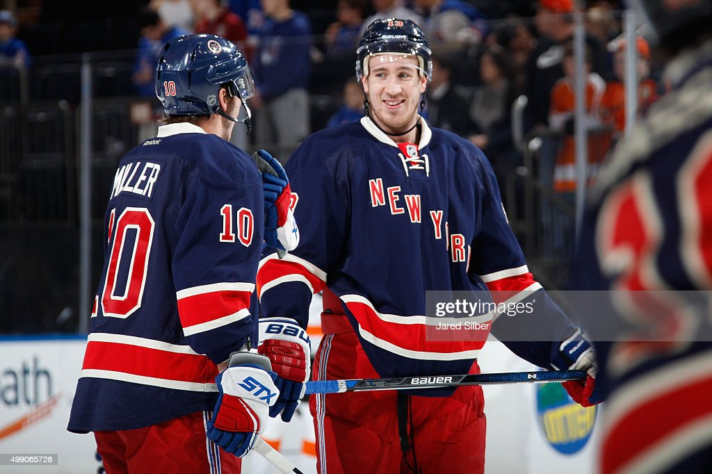 J.T. Miller #10 and Kevin Hayes #13 of the New York Rangers chat during pre game warmups before the game against the Philadelphia Flyers at Madison Square Garden on November 28, 2015 in New York City.