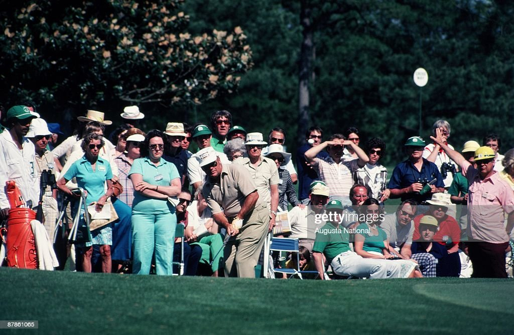 Miller Barber watches his shot in front of a large gallery during the 1979 Masters Tournament at Augusta National Golf Club on April 15th, 1979 in Augusta, Georgia.
