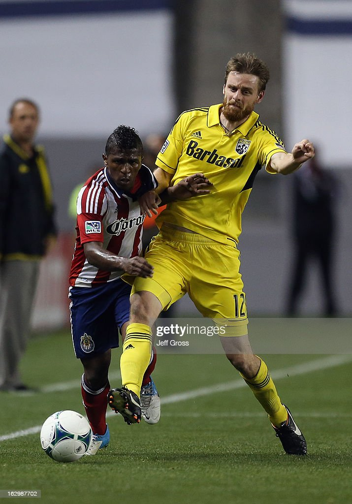 Miller Bolanos #10 of Chivas USA and <a gi-track='captionPersonalityLinkClicked' href=/galleries/search?phrase=Eddie+Gaven&family=editorial&specificpeople=2297558 ng-click='$event.stopPropagation()'>Eddie Gaven</a> #12 of Columbus Crew fight for the ball in the second half at The Home Depot Center on March 2, 2013 in Carson, California. The Crew defeated Chivas USA