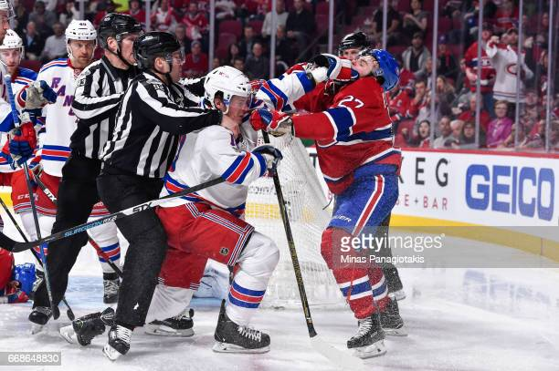 T Miller of the New York Rangers and Alex Galchenyuk of the Montreal Canadiens get physical in Game Two of the Eastern Conference First Round during...
