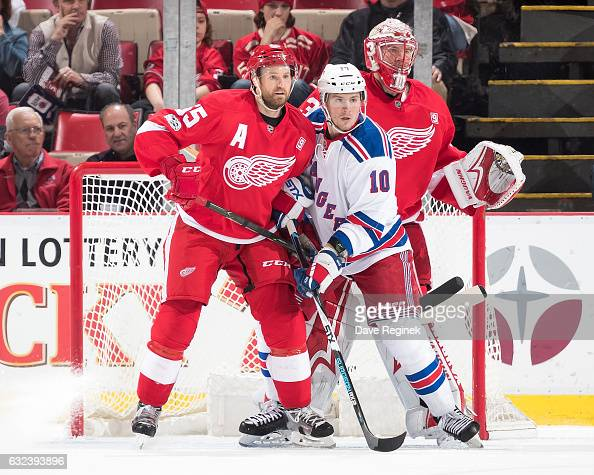 T Miller of the New York Rangers battles for position with Niklas Kronwall of the Detroit Red Wings in front of goaltender Jared Coreau of the Wings...