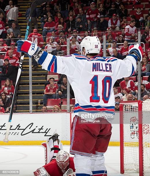 T Miller of the New York Rangers celebrates his overtime goal in front of goaltender Jared Coreau of the Detroit Red Wings during an NHL game at Joe...