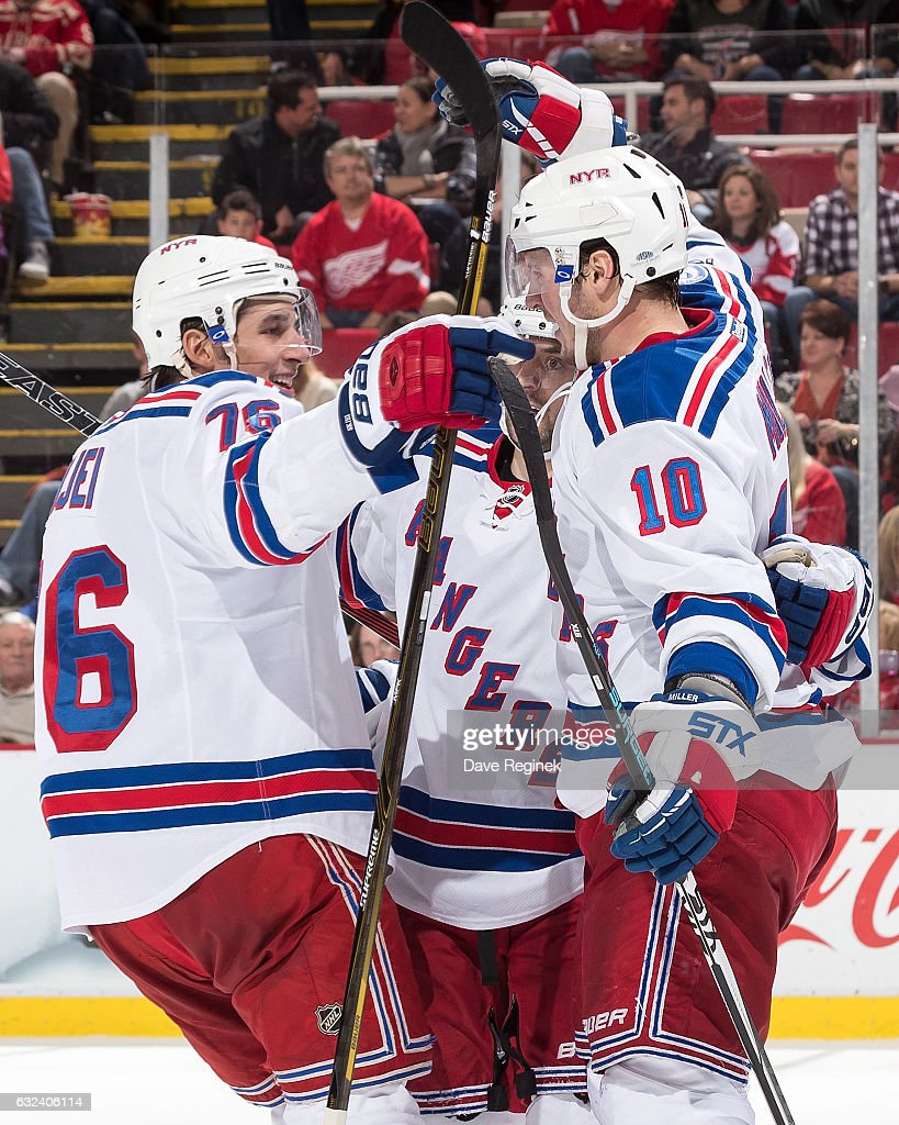 J.T. Miller #10 of the New York Rangers celebrates his overtime goal with teammates Brady Skjei #76 and Mats Zuccarello #36 during an NHL game against the Detroit Red Wings at Joe Louis Arena on January 22, 2017 in Detroit, Michigan. The Rangers defeated the Wings 1-0 in overtime.