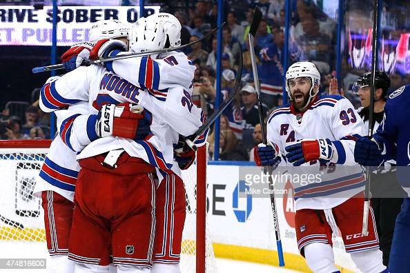 T Miller of the New York Rangers celebrates with his teammates after scoring a goal against Ben Bishop of the Tampa Bay Lightning during the third...