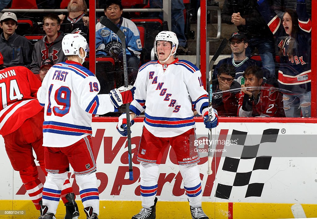 T Miller of the New York Rangers celebrates with teammate Jesper Fast after scoring one of two second period goals during an NHL game against the...