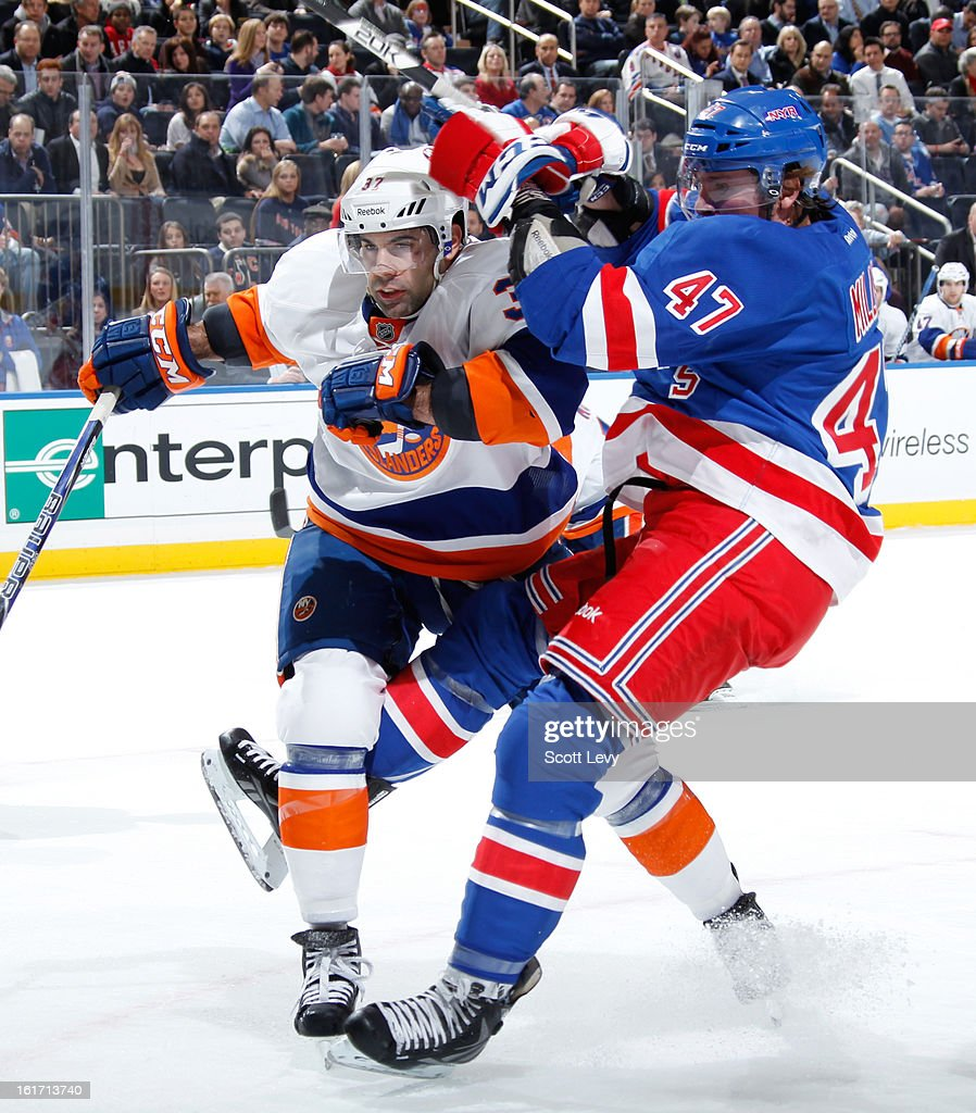 J.T. Miller #47 of the New York Rangers collides with Brian Strait #37 of the New York Islanders at Madison Square Garden on February 14, 2013 in New York City.