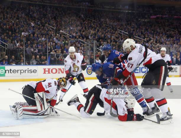 T Miller of the New York Rangers is checked by Ben Harpur of the Ottawa Senators in Game Three of the Eastern Conference Second Round during the 2017...