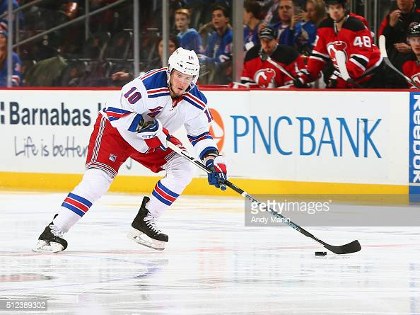 T Miller of the New York Rangers plays the puck during the game against the New Jersey Devils at the Prudential Center on February 23 2016 in Newark...