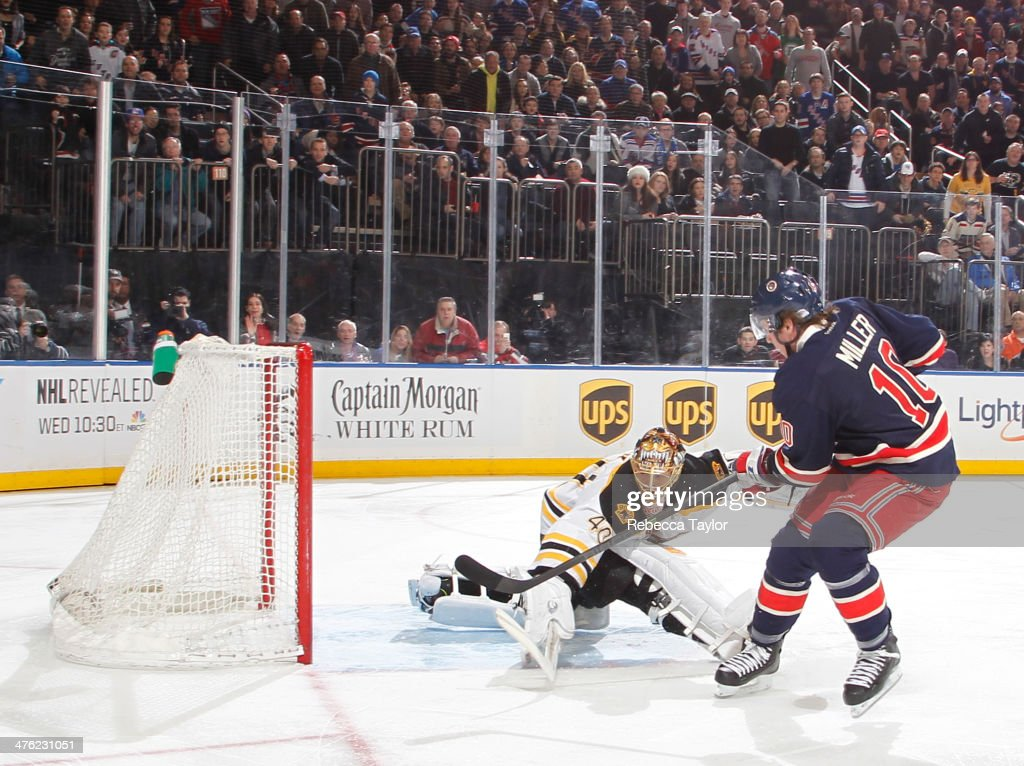 T Miller of the New York Rangers scores a goal on Tuukka Rask of the Boston Bruins during the firstperiod at Madison Square Garden on March 2 2014 in...