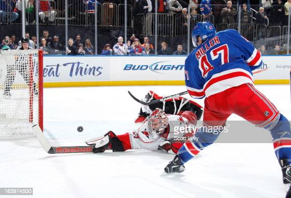 T Miller of the New York Rangers scores a shootout goal against Dan Ellis of the Carolina Hurricanes at Madison Square Garden on March 18 2013 in New...