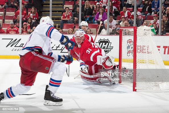 T Miller of the New York Rangers scores an overtime goal on Jared Coreau of the Detroit Red Wings during of an NHL game at Joe Louis Arena on January...