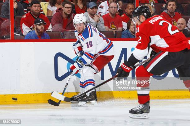 T Miller of the New York Rangers shoots the puck against Dion Phaneuf of the Ottawa Senators in Game Five of the Eastern Conference Second Round...
