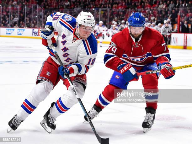 T Miller of the New York Rangers skates against Andrei Markov of the Montreal Canadiens in Game One of the Eastern Conference First Round during the...