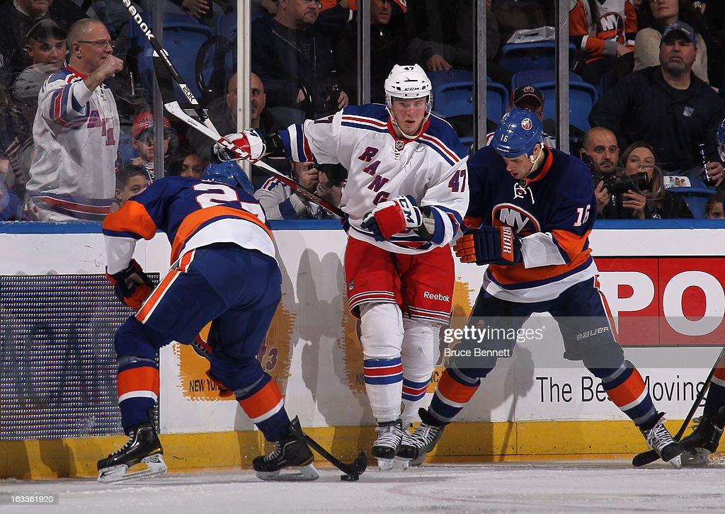 J.T. Miller #47 of the New York Rangers skates against the New York Islanders at the Nassau Veterans Memorial Coliseum on March 7, 2013 in Uniondale, New York. The Rangers defeated the Islanders 2-1 in overtime.
