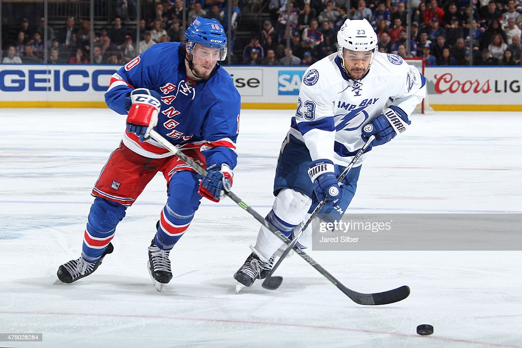 T Miller of the New York Rangers skates for the puck against JT Brown of the Tampa Bay Lightning in Game Five of the Eastern Conference Final during...