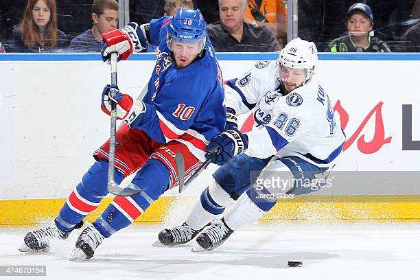 T Miller of the New York Rangers skates with the puck against Nikita Kucherov of the Tampa Bay Lightning in Game Five of the Eastern Conference Final...