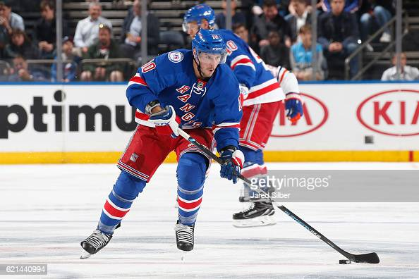 T Miller of the New York Rangers skates with the puck against the Edmonton Oilers at Madison Square Garden on November 3 2016 in New York City The...