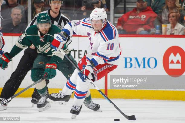 T Miller of the New York Rangers skates with the puck against the Minnesota Wild during the game on March 18 2017 at the Xcel Energy Center in St...