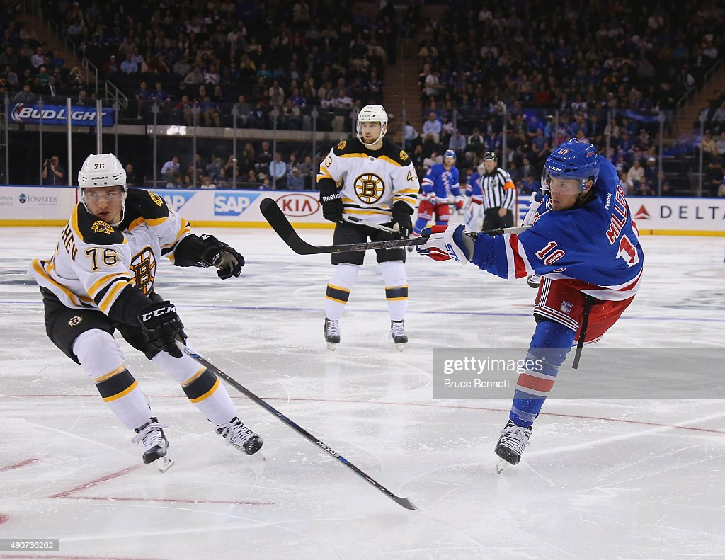 T Miller of the New York Rangers takes the second period shot against the Boston Bruins at Madison Square Garden on September 30 2015 in New York City