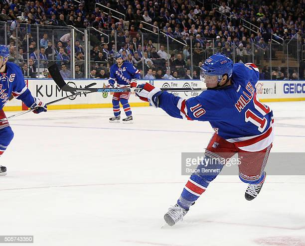 T Miller of the New York Rangers takes the shot against the Vancouver Canucks at Madison Square Garden on January 19 2016 in New York City The...