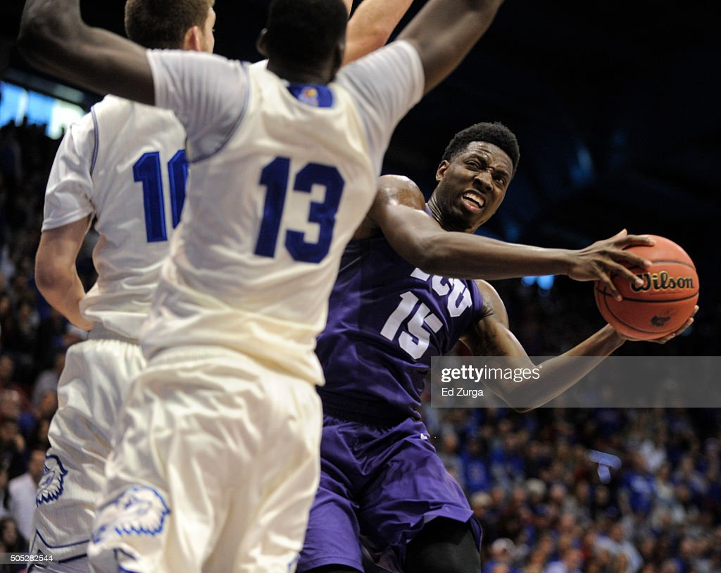Miller of the TCU Horned Frogs looks to shoot against Sviatoslav Mykhailiuk and Cheick Diallo in the second half at Allen Fieldhouse on January 16...