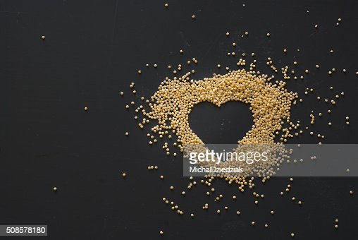 millet heart on dark wooden table : Stockfoto