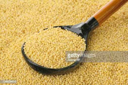 Millet in a spoon : Stock Photo