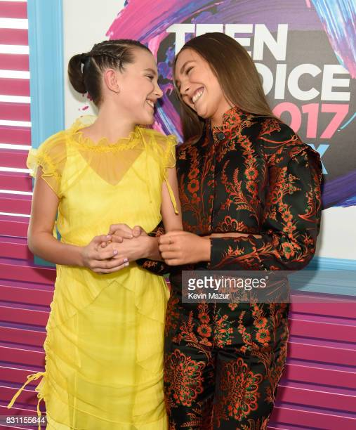 Millie Bobby Brown and Maddie Ziegler attend the Teen Choice Awards 2017 at Galen Center on August 13 2017 in Los Angeles California