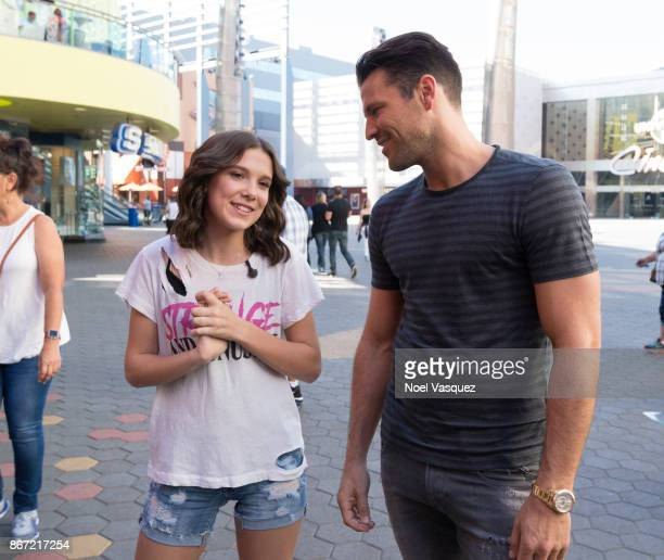 Millie Bobby Brown and Mark Wright visit 'Extra' at Universal Studios Hollywood on October 27 2017 in Universal City California