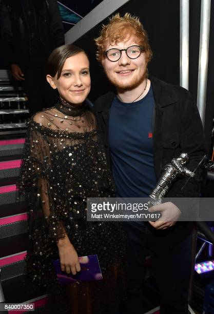 Millie Bobby Brown poses backstage with Ed Sheeran winner of the Artist of the Year award during the 2017 MTV Video Music Awards at The Forum on...