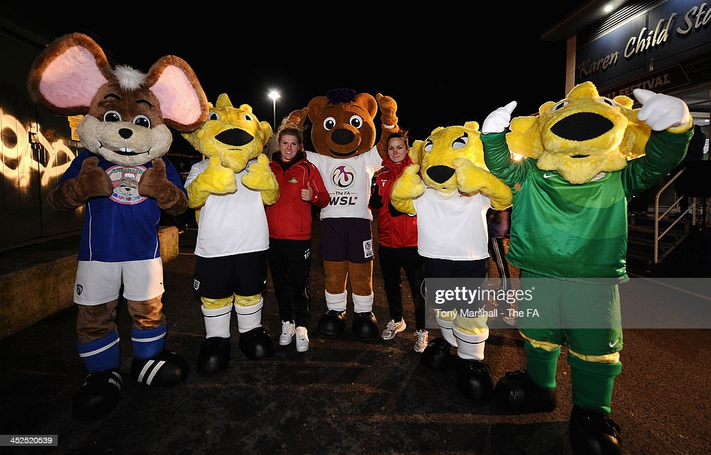 Millie Bright and Nicloa Hobbs of Doncaster Rovers Belles with the mascots at the FA Girls Fanzone before the UEFA Womens U17 Championship Finals match between England and Austria at Chesterfield FC Stadium on November 29, 2013 in Chesterfield, England.