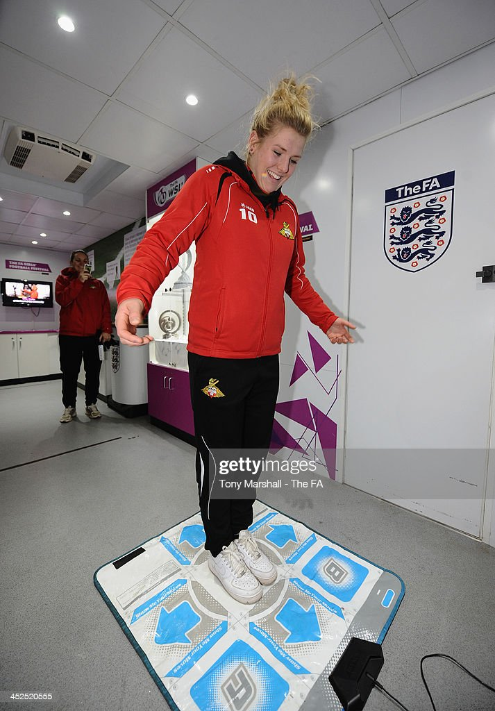 Millie Bright of Doncaster Rovers Belles taking part on the Dance Mat at the FA Girls Fanzone before the UEFA Womens U17 Championship Finals match between England and Austria at Chesterfield FC Stadium on November 29, 2013 in Chesterfield, England.