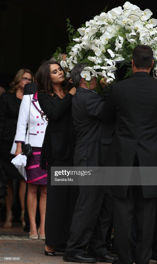 Millie Elder-Holmes carries her Dad, Sir Paul Holmes out of the church at Auckland Cathedral of the Holy Trinity in Parnell on February 8, 2013 in Auckland, New Zealand. Hundreds gathered to pay their respects to Sir Paul Homes who passed away last Friday after losing his battle with prostate cancer. Holmes' broadcasting career spanned over 40 years on radio and television in New Zealand, Australia, Netherlands and the UK.