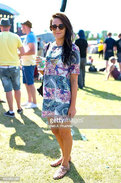 Millie Long a Student from Portsmouth poses wearing a dress by River Island and shoes by Primark at The Isle of Wight Festival as Seaclose Park on...