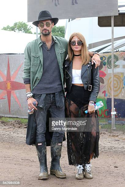 Millie Mackintosh and Hugo Taylor attends Day 2 of the Glastonbury Festival 2016 at Worthy Farm Pilton on June 25 2016 in Glastonbury England