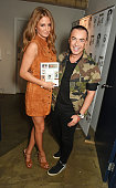 Millie Mackintosh and Julien Macdonald attend the launch of 'Made A Book of Style Food and Fitness' by Millie Mackintosh at Carousel London on...