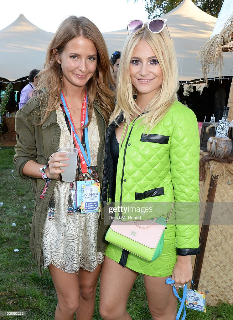 Millie Mackintosh (L) and Pixie Lott attend the Mahiki Rum Bar for the launch of the Mahiki Rum Family backstage during day 1 of the V Festival 2014 at Hylands Park on August 16, 2014 in Chelmsford, England.