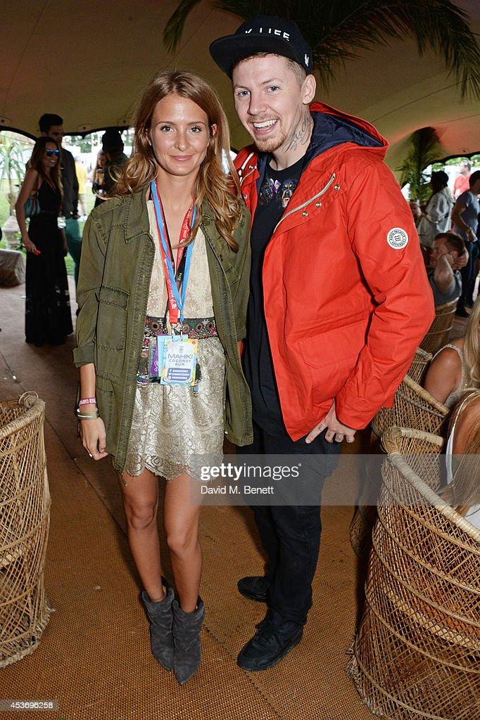 Millie Mackintosh (L) and Professor Green attend the Mahiki Rum Bar for the launch of the Mahiki Rum Family backstage during day 1 of the V Festival 2014 at Hylands Park on August 16, 2014 in Chelmsford, England.