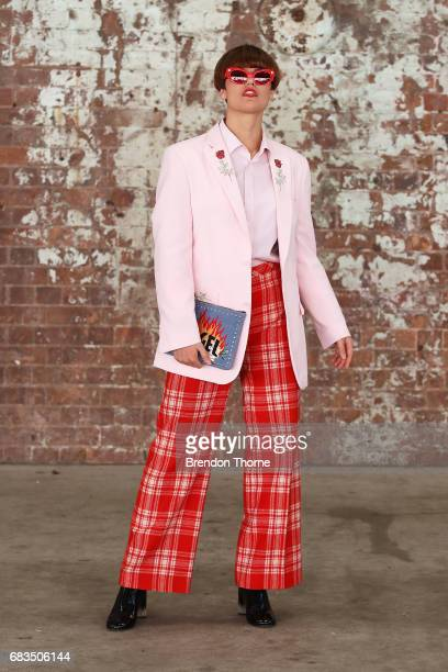 Millie Sykes wearing Laurel and Hector blazer Reuze tartan pants Poppy Lissiman accessories during MercedesBenz Fashion Week Resort 18 Collections at...
