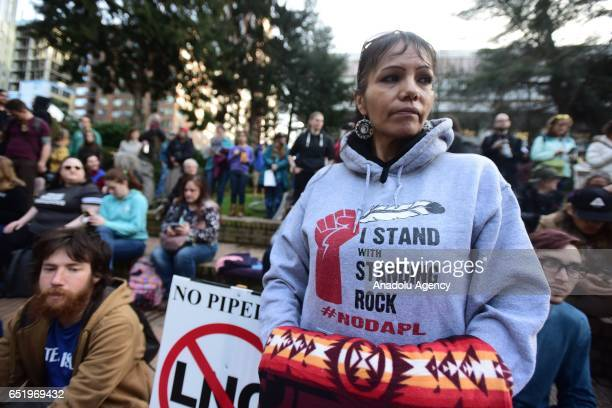 Millie Wahl stands in solidarity with the 'Native Nations Rise' march on Washington DC against the construction of the Dakota Access Pipeline in...