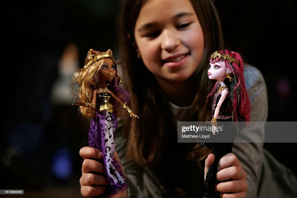 Millie Walford, (9), plays with the Monster High 13 Wishes Doll by Mattel at a media event at St Mary's Church in Marylebone on November 6, 2013 in London, England. The Toy Retailers Association's Dream Toys chart, is an independent list of the predicted Christmas top 12 best-selling gifts for children.